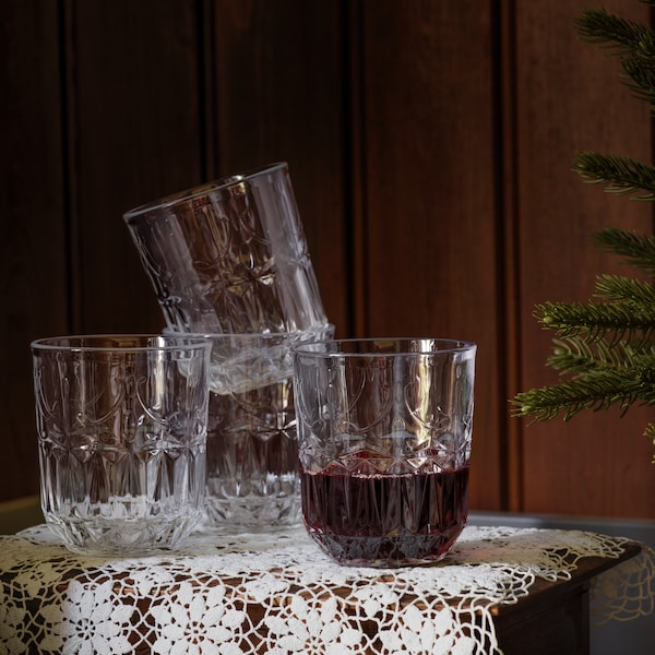 Small glass cups stacked on lace cloth