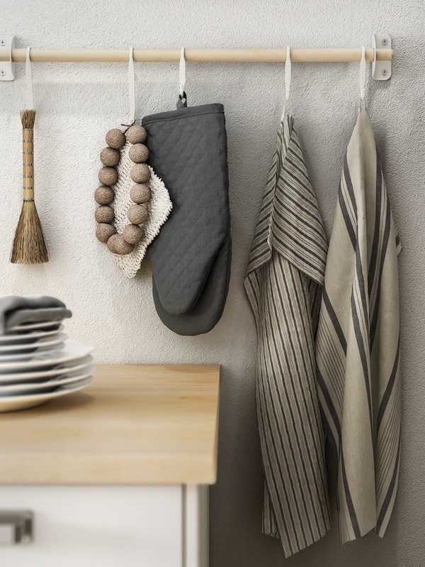 NEREBY birch rail with striped grey/beige MARIATHERES tea towels and a dark grey oven glove hanging on white NEREBY s-hooks.