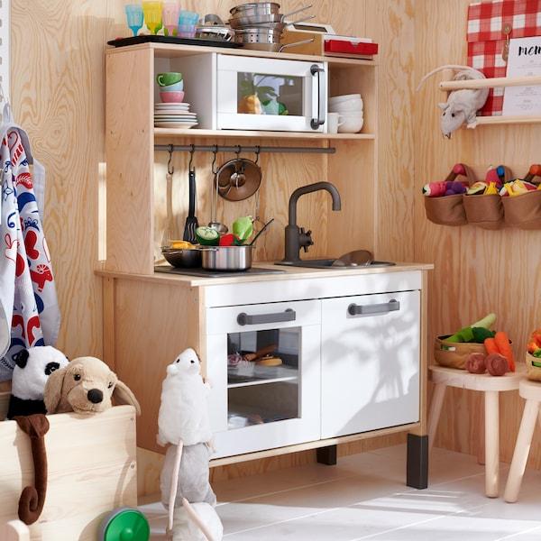 DUKTIG play kitchen in birch with DUKTIG toys.