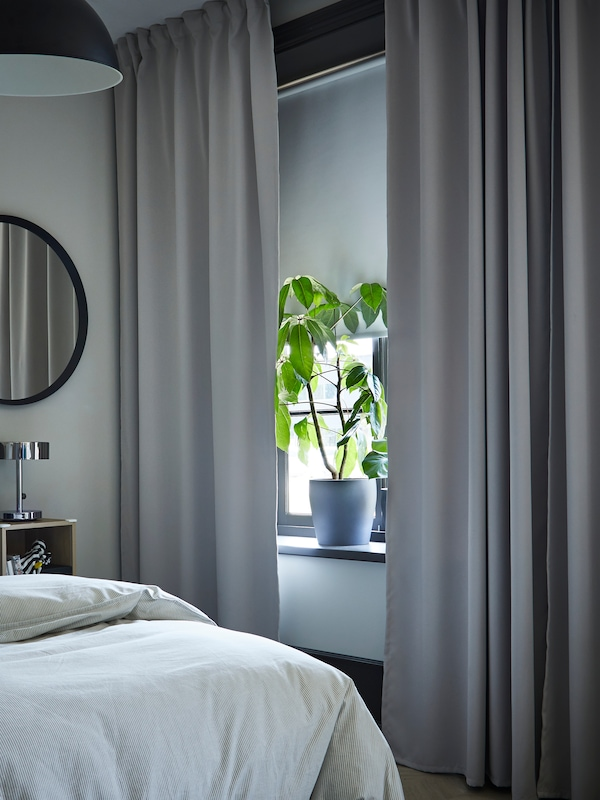 A close up of MAJGULL curtains in a bedroom.