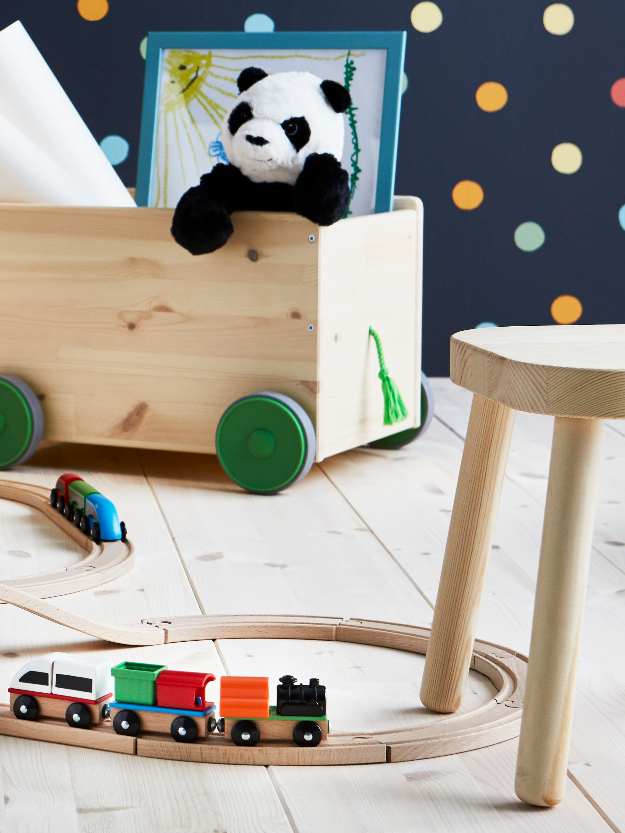 A LILLABO wooden train set with a train laid out on a wooden floor.