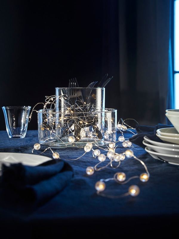 A light chain is used as a table decoration.