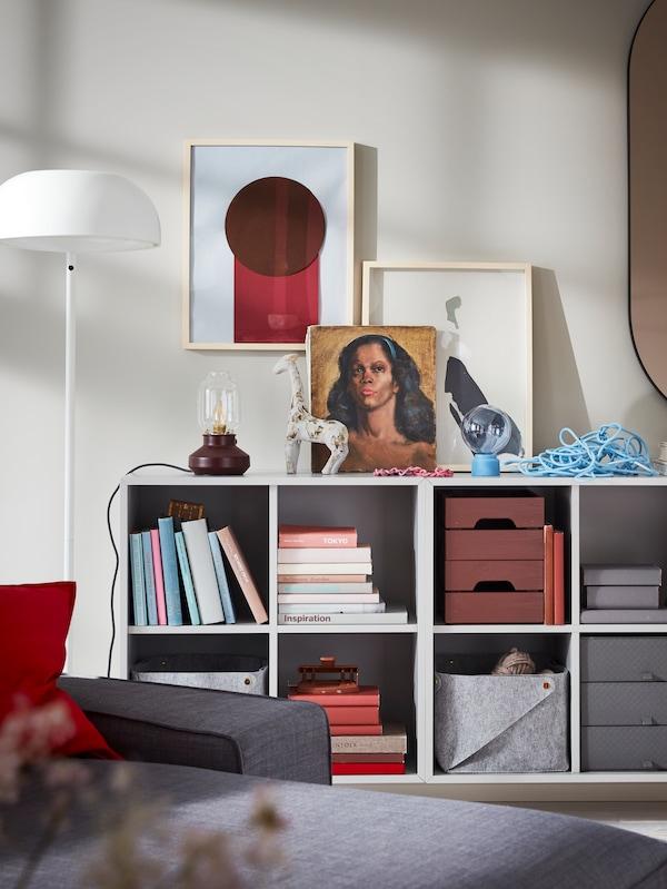 A bookshelf and some frame art.
