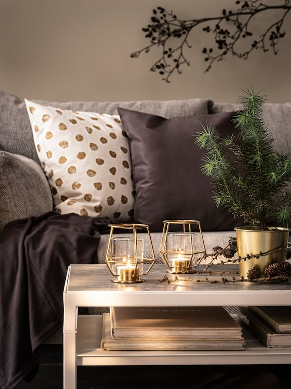 Gold polka dot and grey cushion on a couch