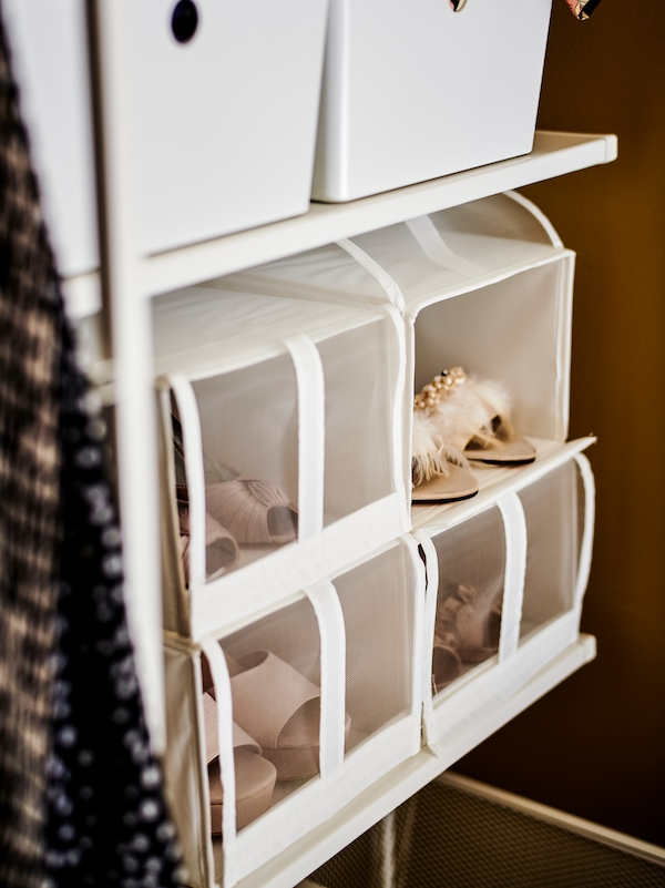 A SKUBB organizer storing multiple pairs of womens shoes