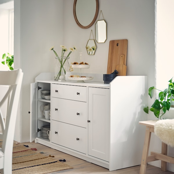 A white sideboard against a white wall.