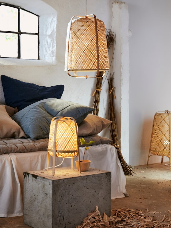 A collection of three woven KNIXHULT lighting fixtures.