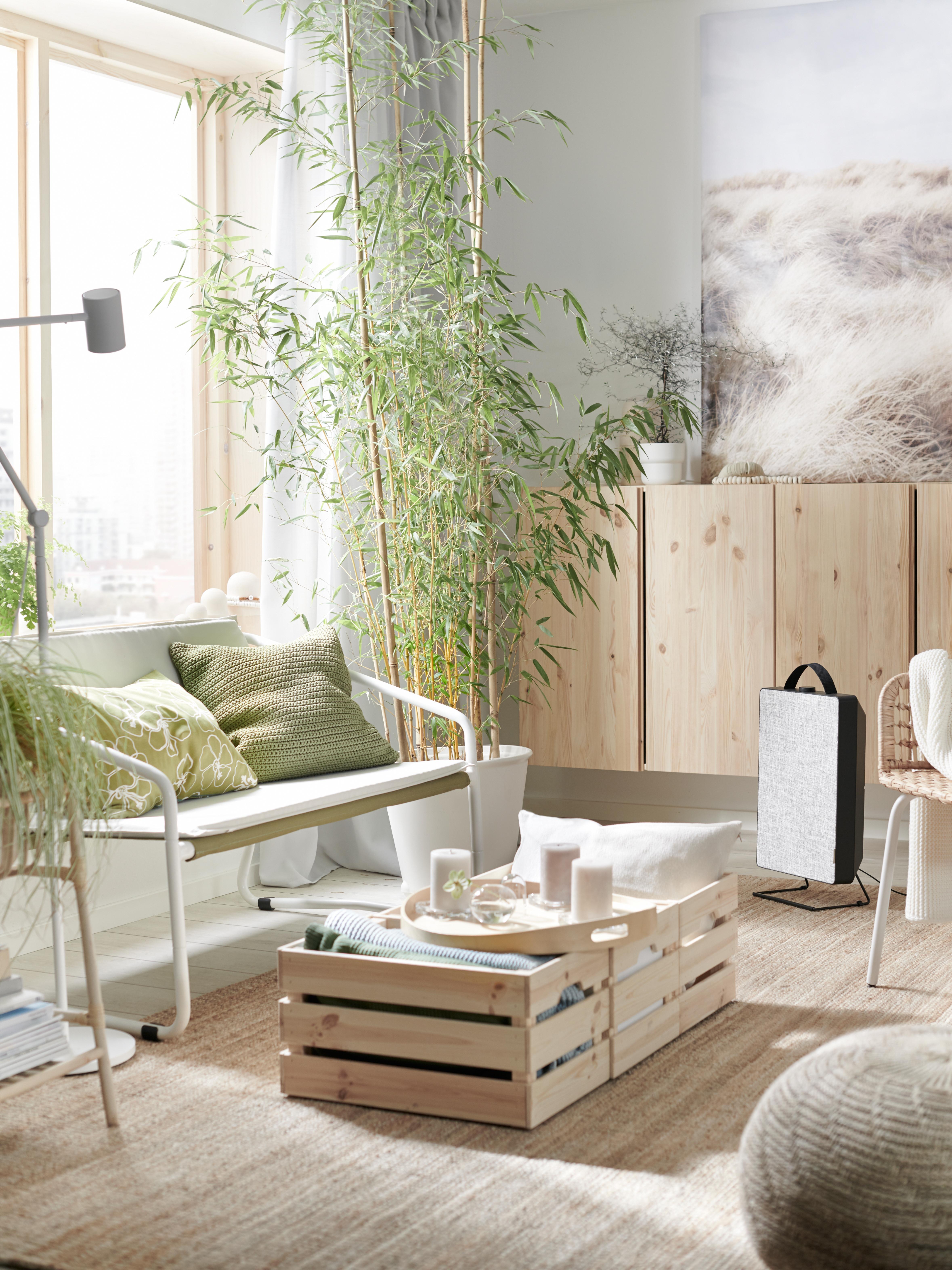 Living room with INGMARSÖ sofa, SANDARED pouffe, SÖTHOLMEN cushion covers, IVAR cabinet, KNAGGLIG box and air purifier.