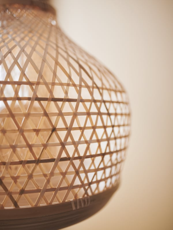 The MISTERHULT pendant lamp is made of hand-woven bamboo.