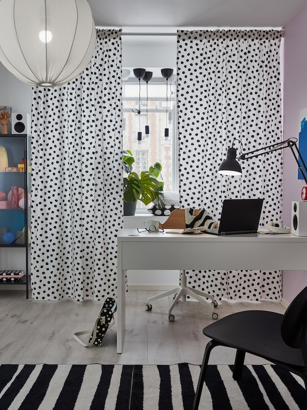 SKÄGGÖRT fabric is used as curtains in a room and provides privacy and shade for the MICKE desk in front of the window.