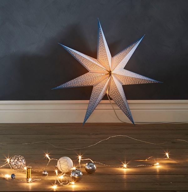 Festive lighting sitting on a wooden floor