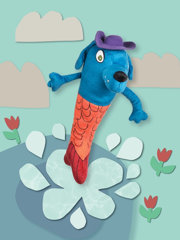 The SAGOSKATT 2021 mermaid-dog soft toy is standing in an illustrated flower bed.