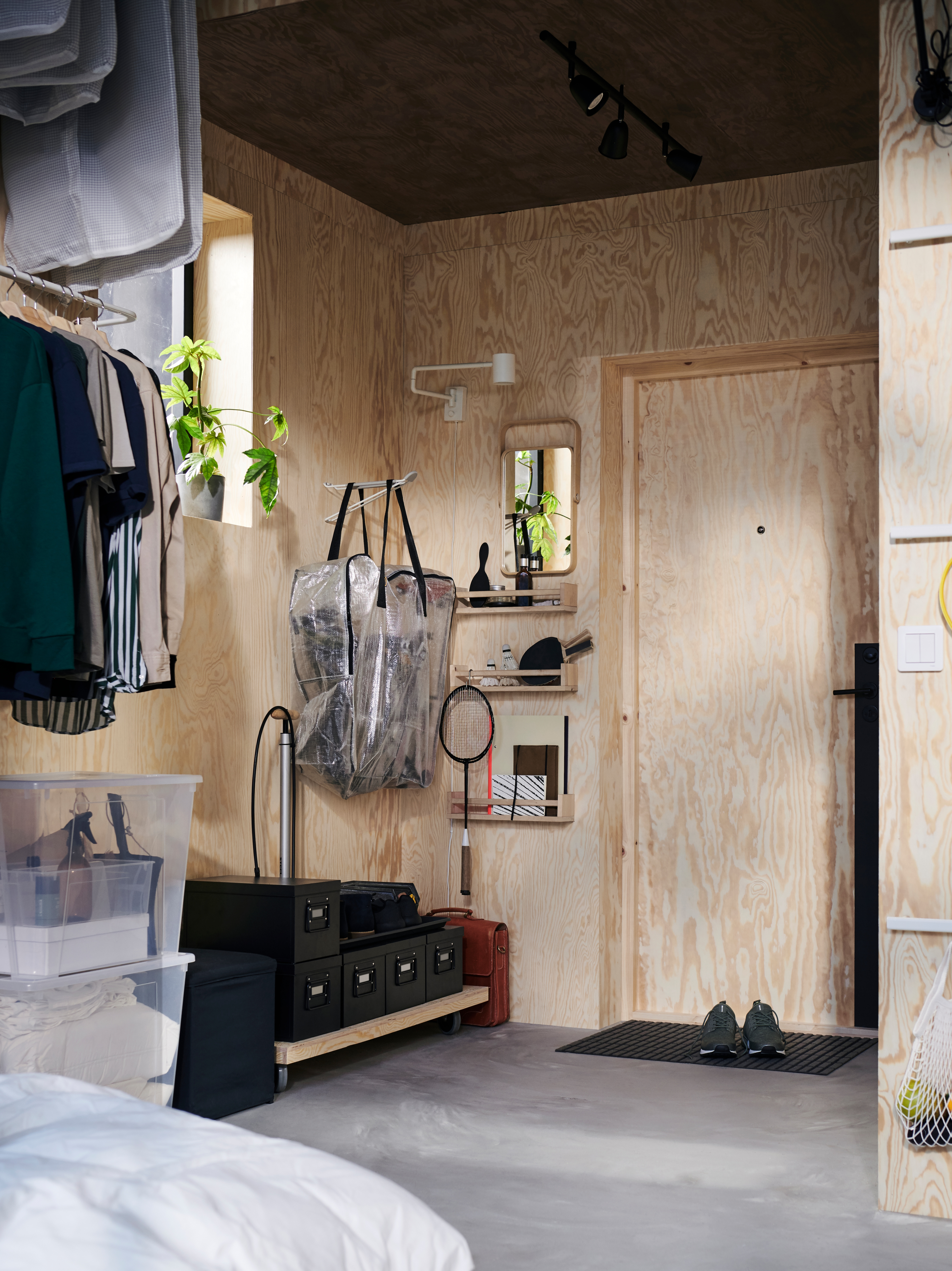 Storage shed, with BOSNÄS footstool, two SAMLA boxes with lid, DIMPA storage bag, NYMÅNE wall lamp, and clothes.