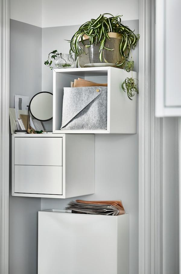 Armario EKET con y sin cajones  en color blanco con planta encima