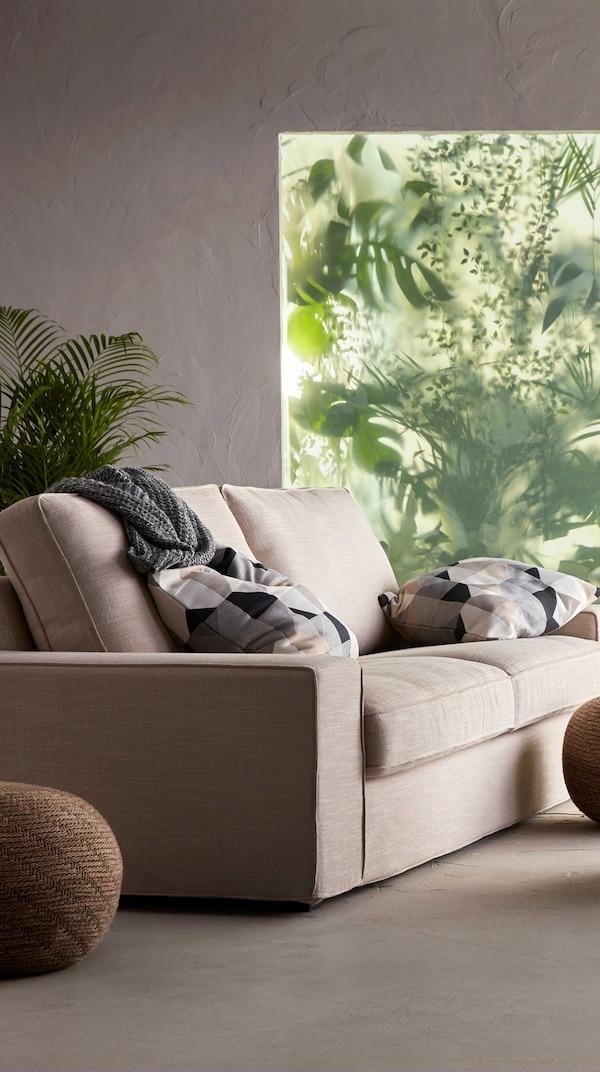 Beige KIVIK 2-seater sofa sitting in neutral living room. Large window in background.