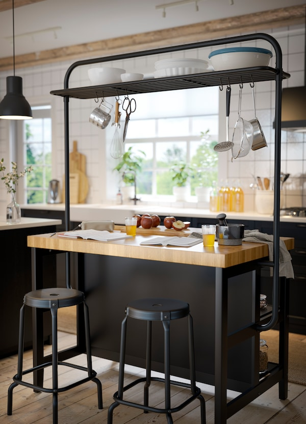 A kitchen island, ready to host breakfast for two.