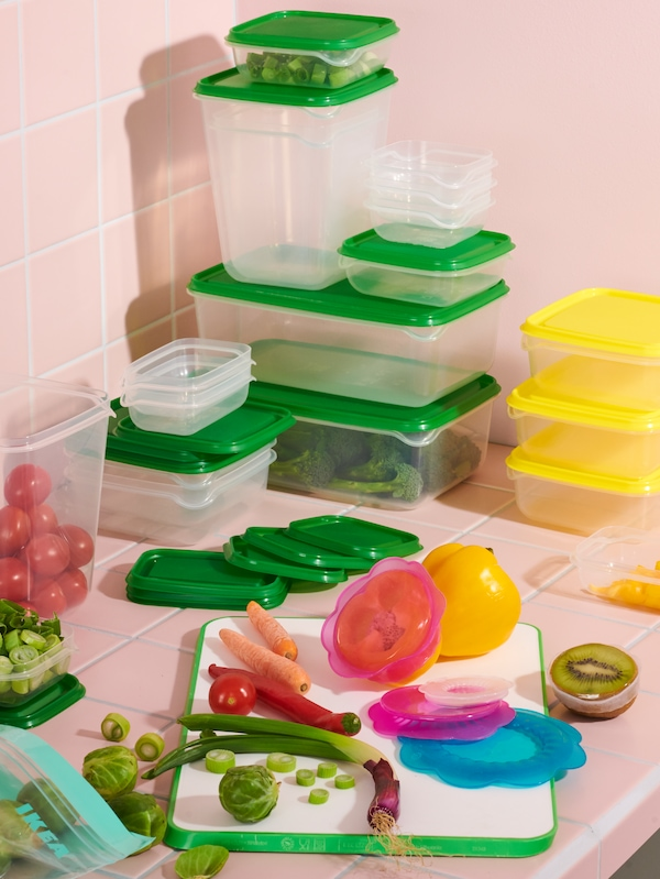 PRUTA food storage containers stacked. Vegetables sitting on MATLUST cutting board