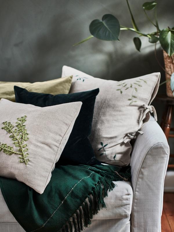 Colorful cushions on an armchair.