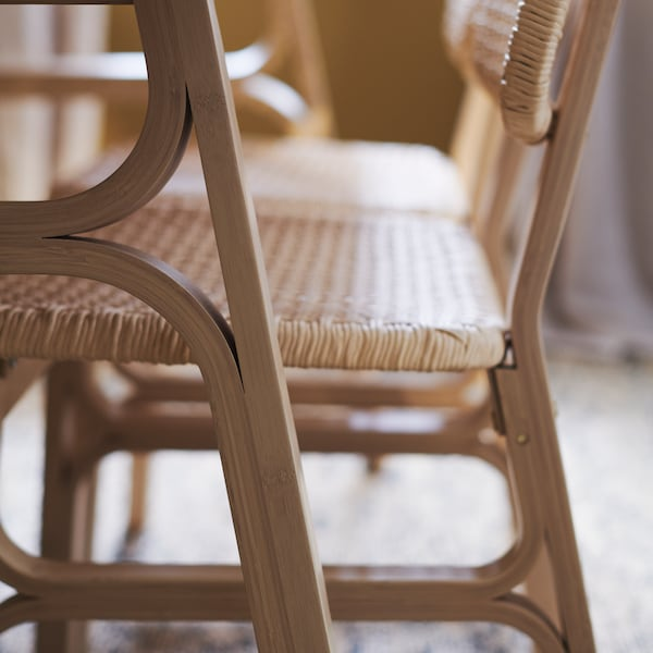 The seat and backrest of the VOXLÖV chair are made from handwoven paper twine.