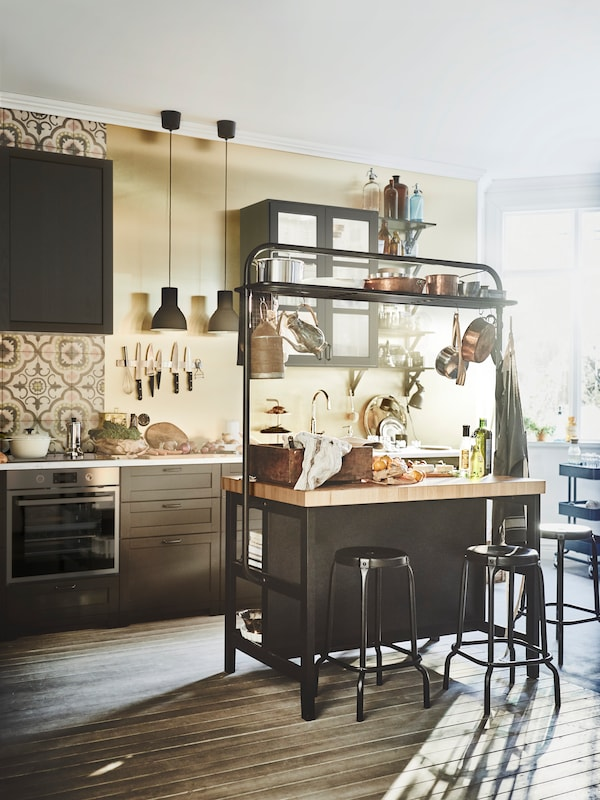 VADHOLMA kitchen island with rack in black/oak is pefect to gather around the kitchen island.