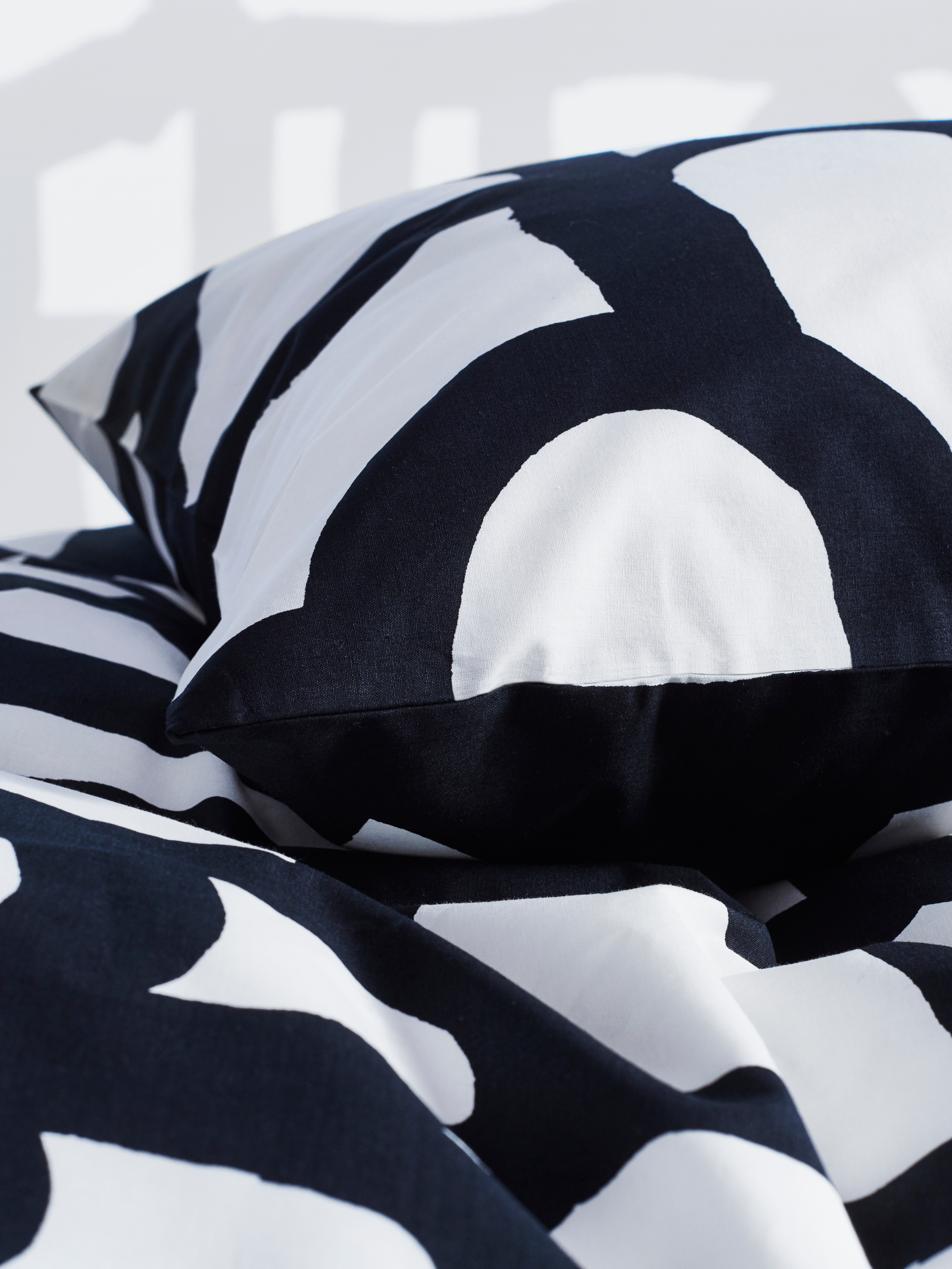 SKUGGBRÄCKA quilt cover and pillowcase in black and white against a white background.