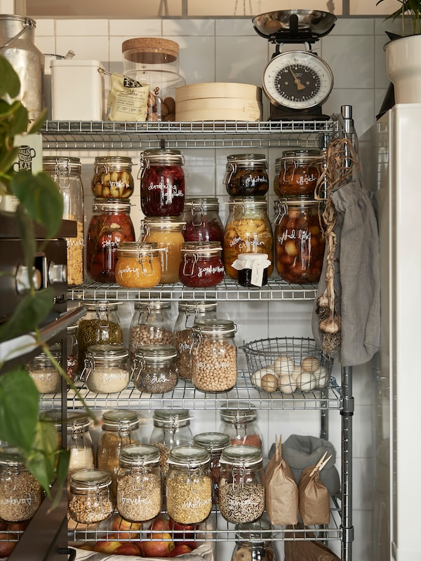 One IKEA OMAR shelf section storing several IKEA KORKEN glass jars containing dry food and cooking ingredients.