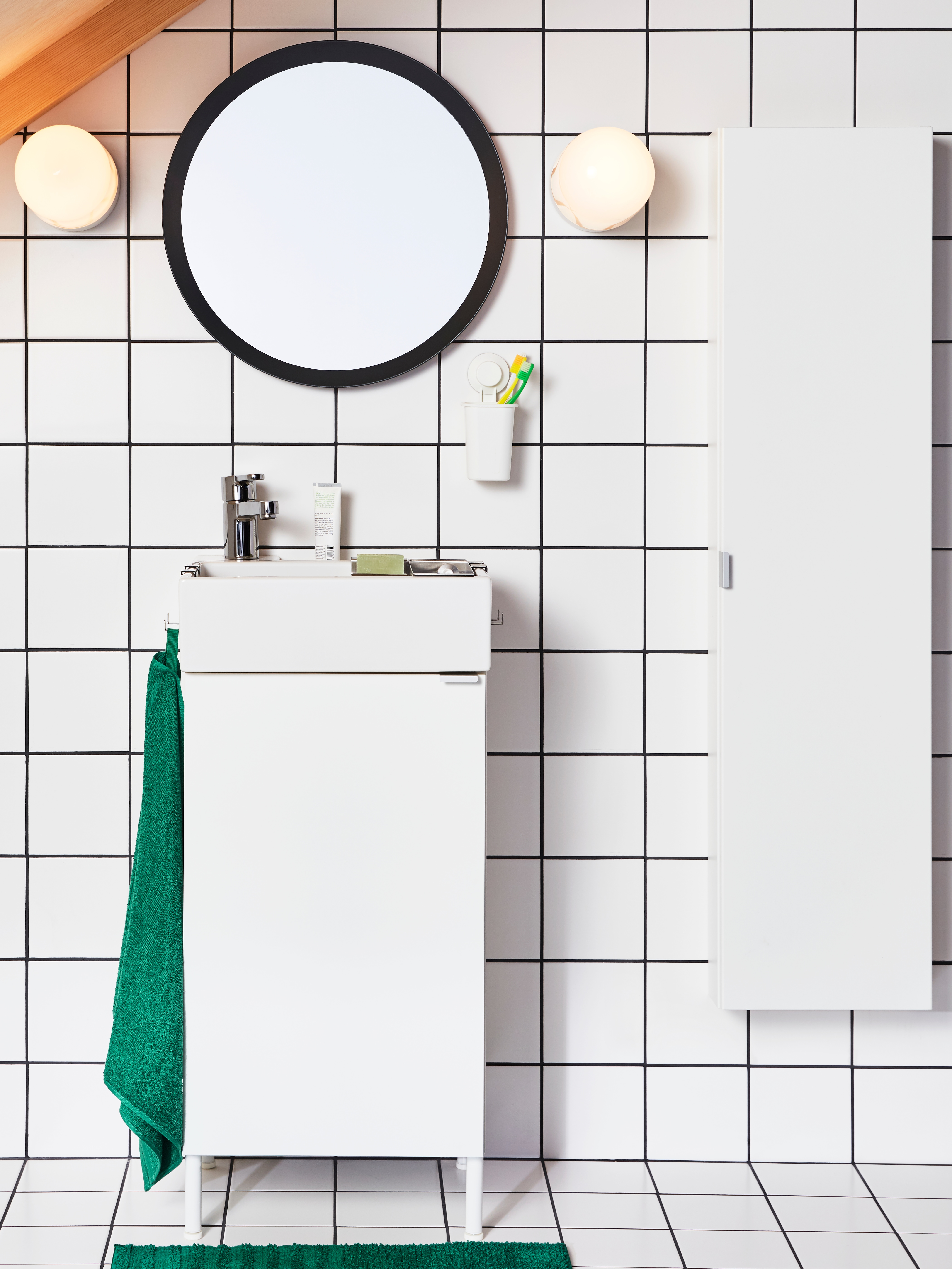 An image showing a white small-space bathroom next to a blue background with text about the IKEA bathroom planner.