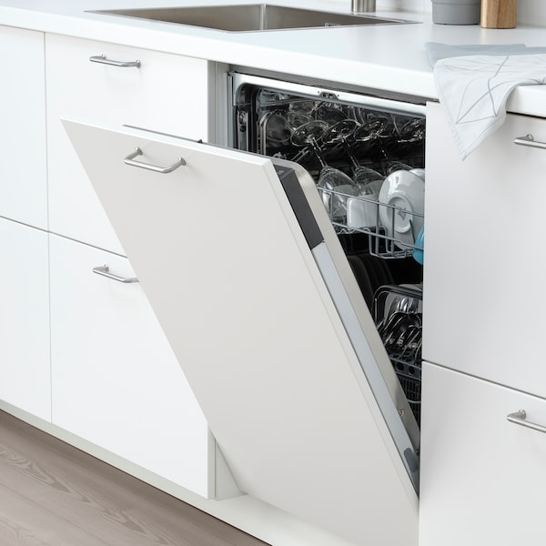 A white LAGAN dishwasher stands next to a white cabinet in a white kitchen.