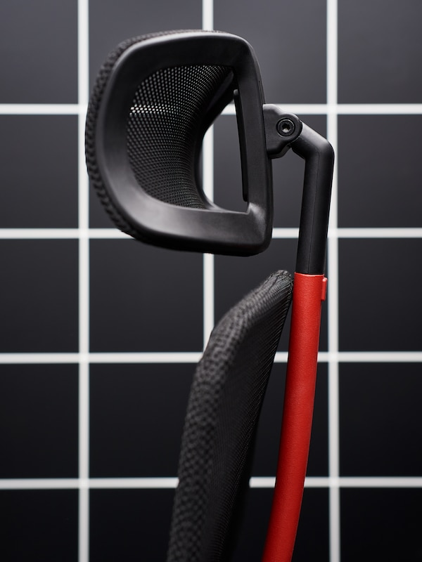 Close-up of the MATCHSPEL gaming chair in a dark gaming room.