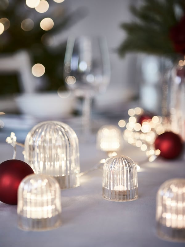 A close up of VINTERFEST lights and decorations on a table