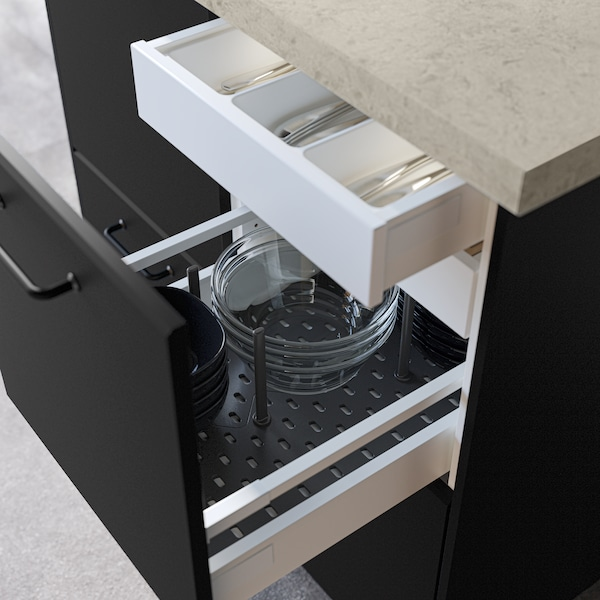 Drawer  with a black UPDATERA stand, with three stacked bowls.