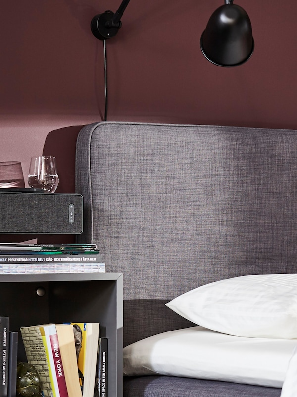 A boxspring bed with a SYMFONISK wifi speaker
