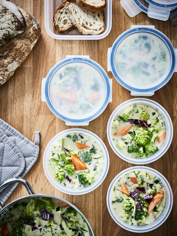Round food storage containers filled with soup