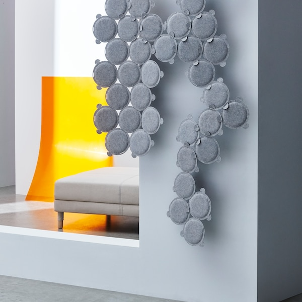 A close up of a grey sound absorbing pane.