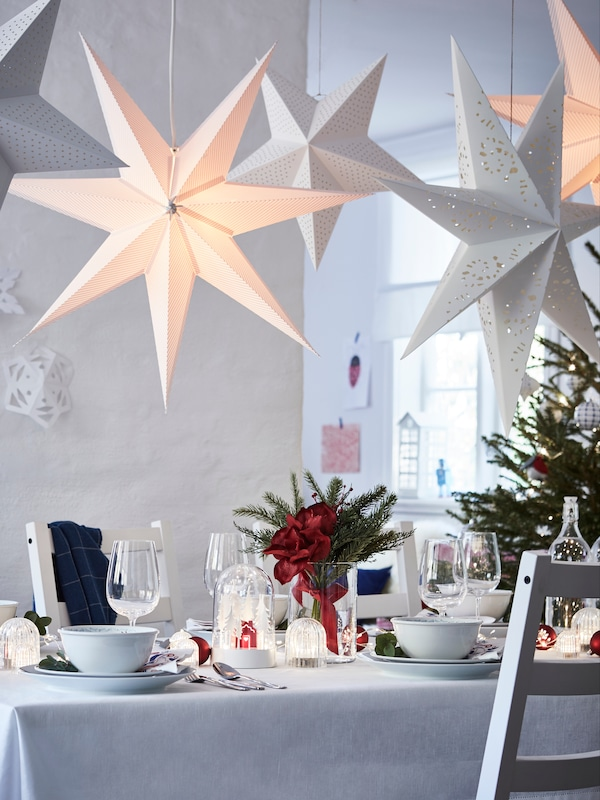 A beautifully decorated festive white dining room