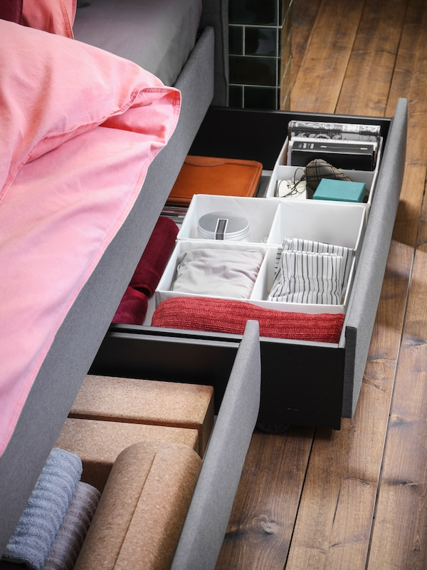Grey HAUGA bed with pull out storage underneath