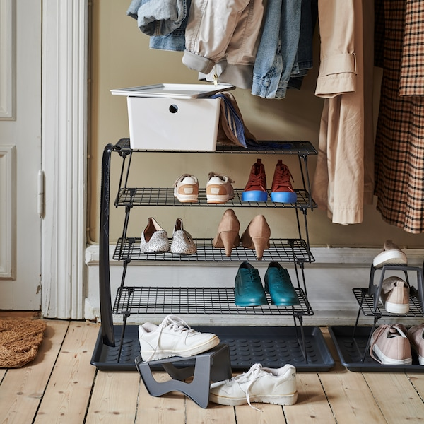A  GREJIG shoe stand sits in a light natural hallway with a MURVEL shoe stand at it's base.