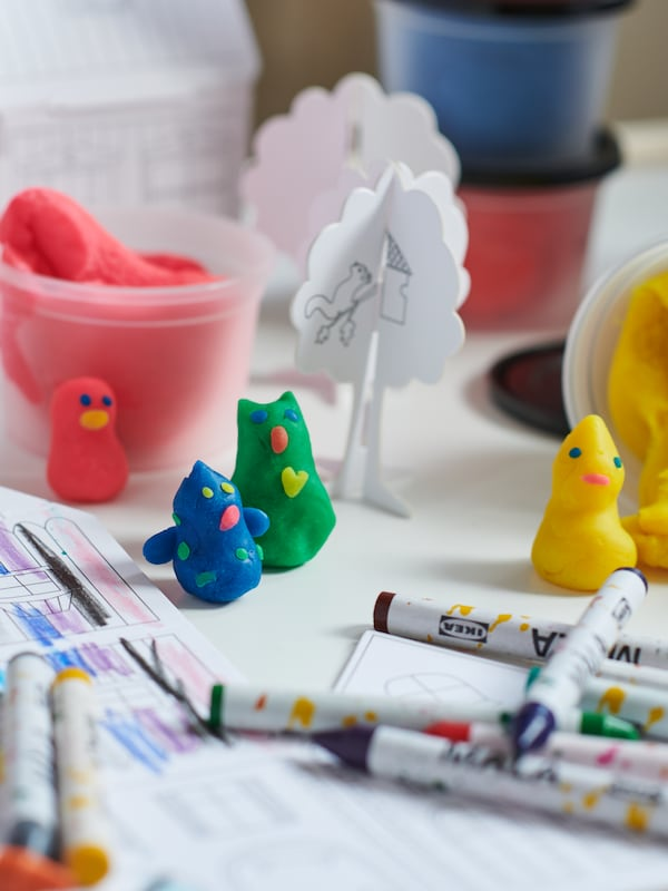 Close-up of crayons and molding clay.