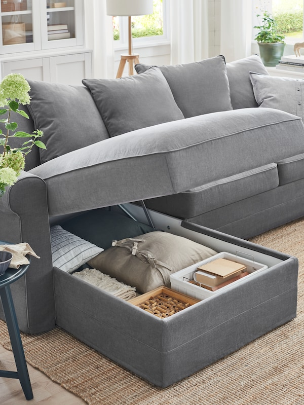GRÖNLID three-seat sofa with chaise longue, the top open with hidden storage compartment inside.
