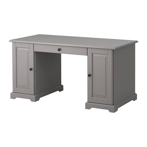 LIATORP Työpöytä IKEA Siirrettävän hyllylevyn ansiosta kaappiin saa tarvittaessa tilaa myös tietokoneelle.