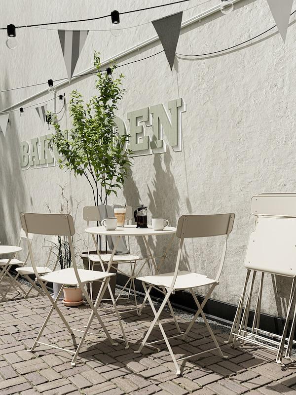 SALTHOLMEN Table, extérieur, pliable beige, 65 cm