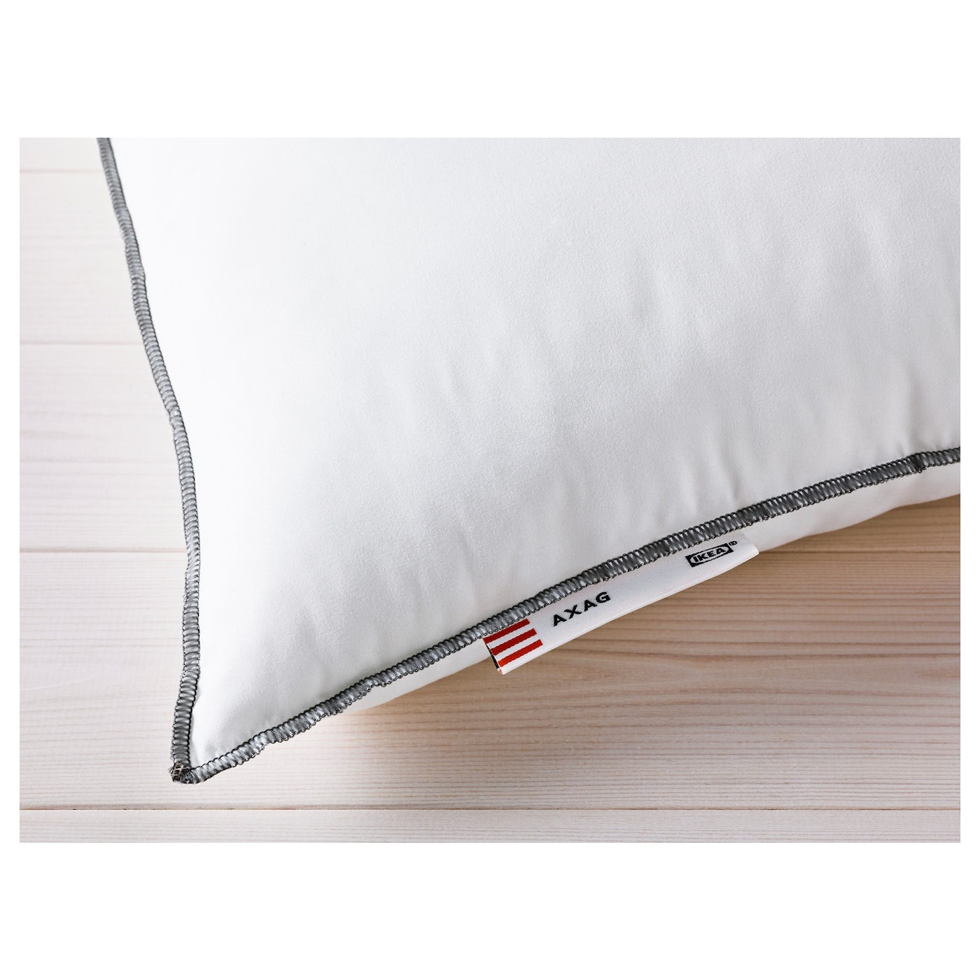 IKEA AXAG pillow, firmer Easy-care pillow with a brushed microfibre fabric for a soft feel.