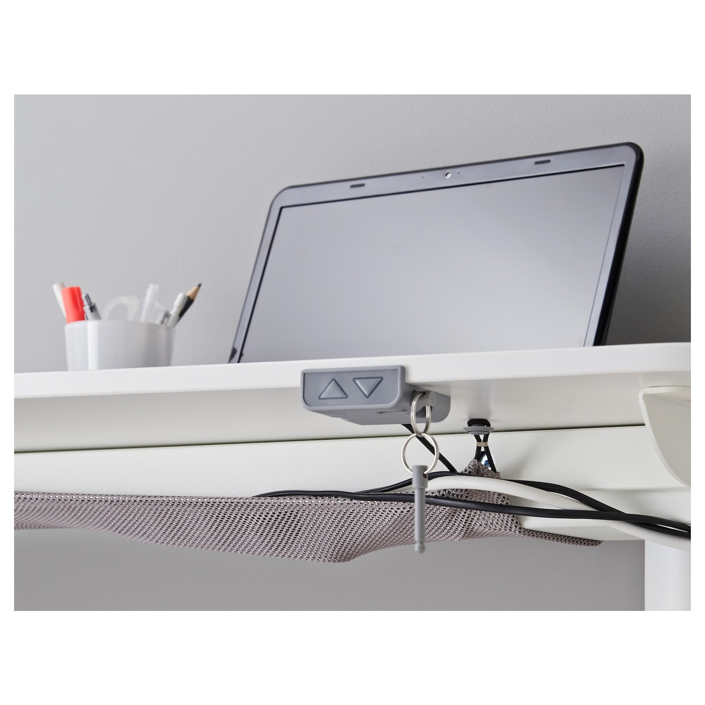 IKEA BEKANT desk sit/stand with screen Holds pins; also serves as notice board.