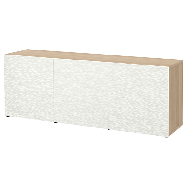 BESTÅ Storage combination with doors, white stained oak effect/Laxviken white, 180x42x65 cm
