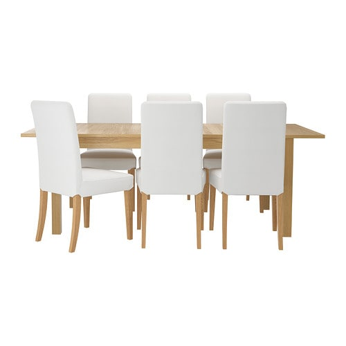 IKEA BJURSTA/HENRIKSDAL table and 6 chairs The clear-lacquered surface is easy to wipe clean.