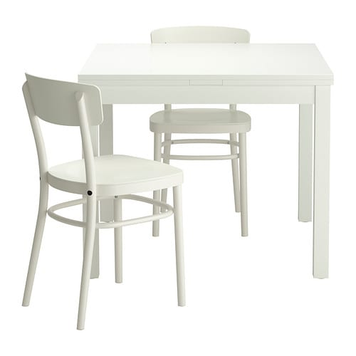 IKEA BJURSTA/IDOLF table and 2 chairs The clear-lacquered surface is easy to wipe clean.