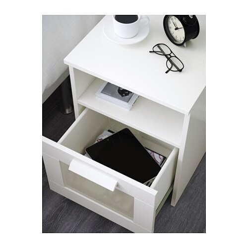 ikea brimnes bedside table in the drawer there is room for an