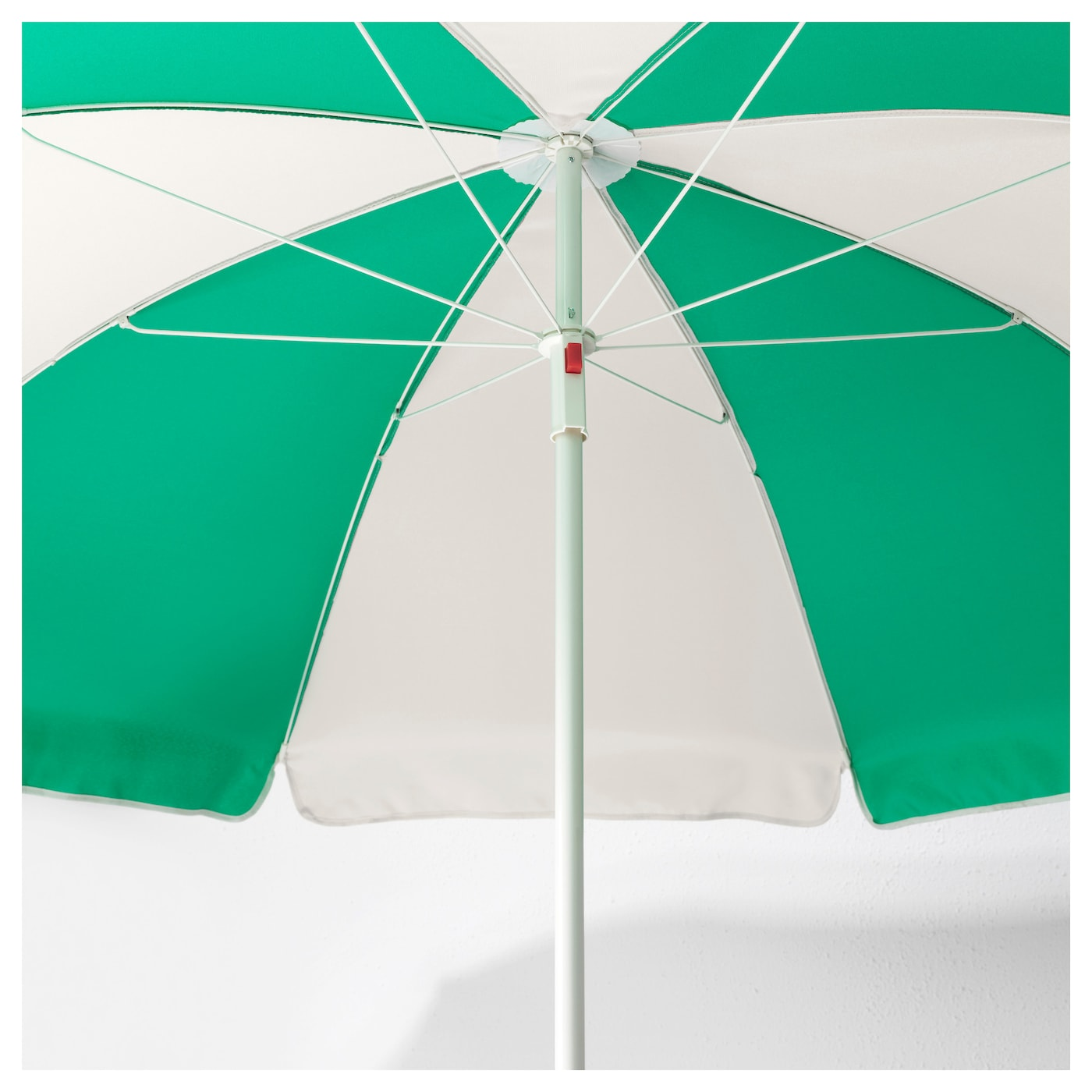 IKEA FISKÖ/RAMSÖ parasol with base The hook-and-loop strap keeps the fabric in place when folded.