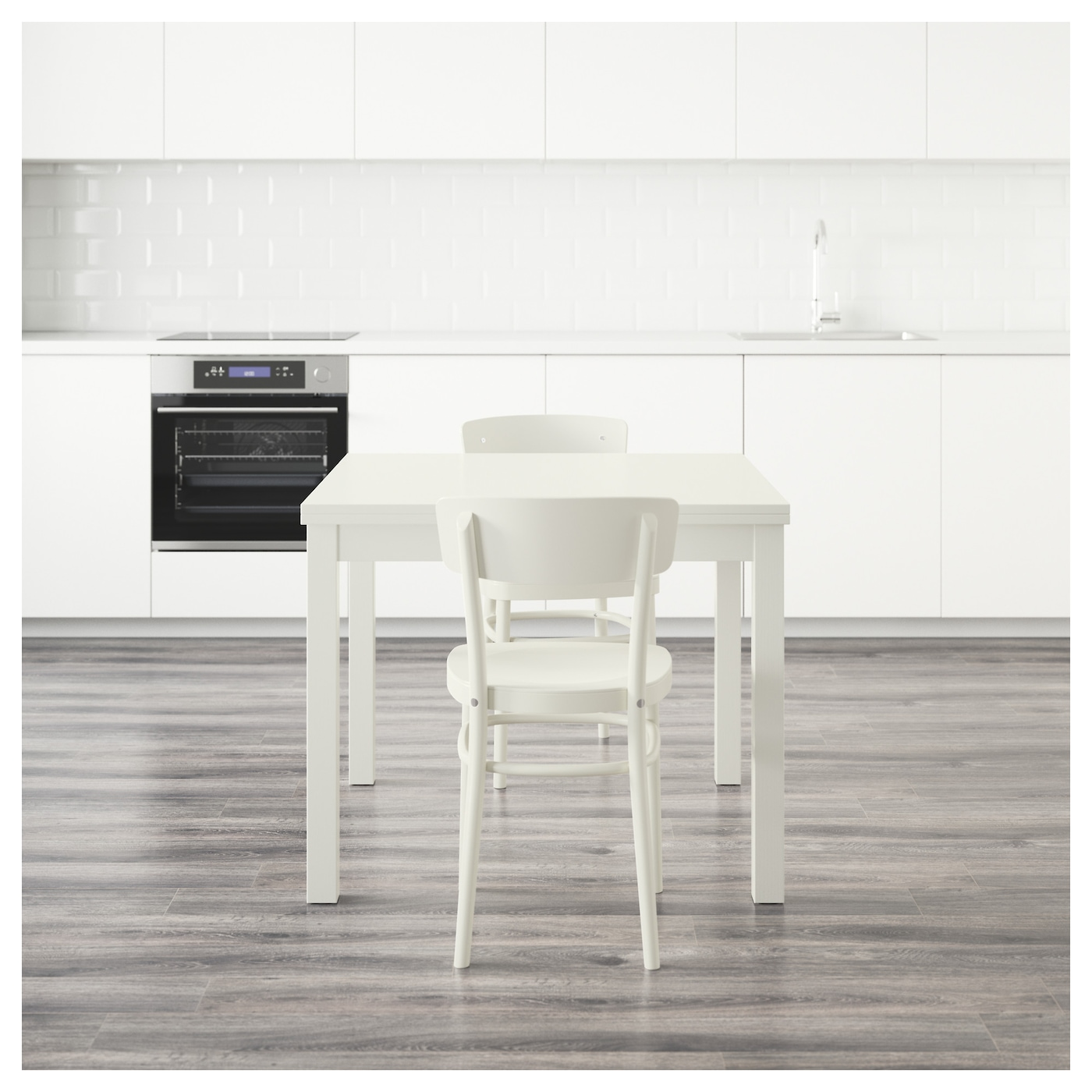 IKEA IDOLF/BJURSTA table and 2 chairs The clear-lacquered surface is easy to wipe clean.