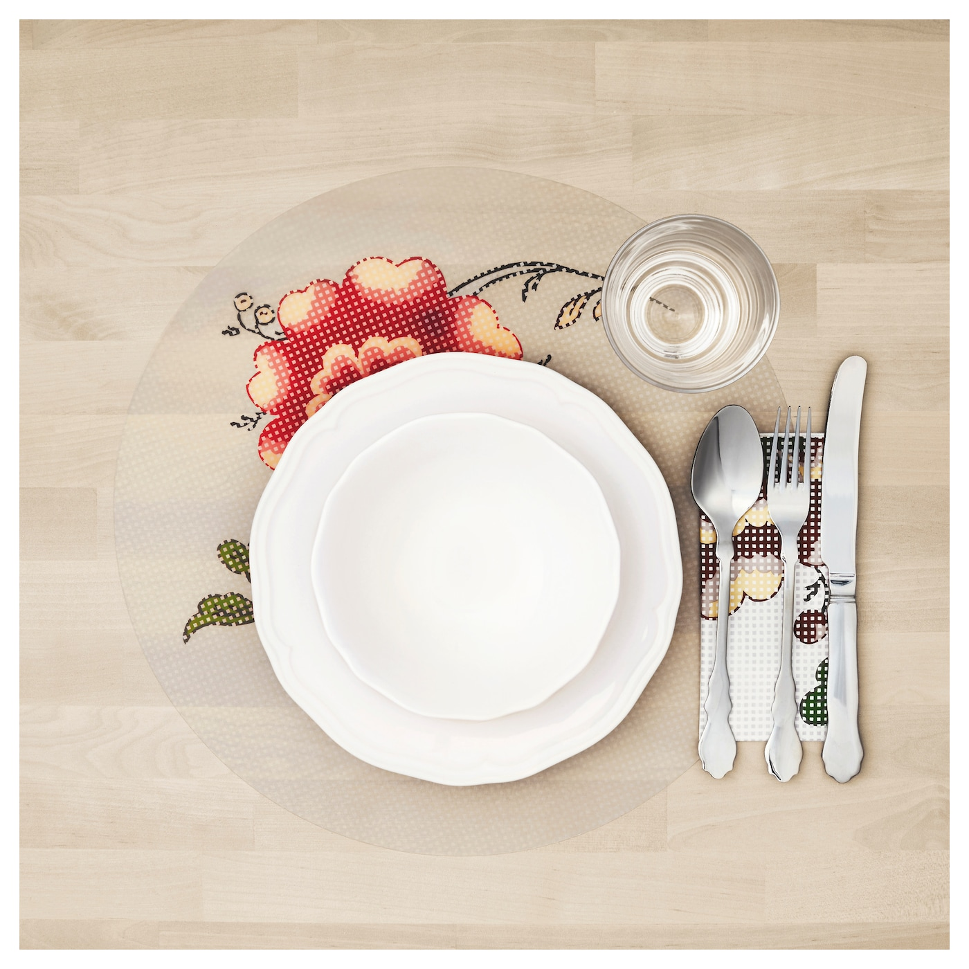 IKEA INBJUDANDE place mat Protects the table top surface and reduces noise from plates and cutlery.